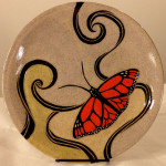 Round stoneware plate with sgraffito carved monarch butterfly design