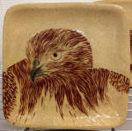 Stoneware plate, sgraffito red tailed hawk