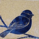 Stoneware tile, sgraffito carved chickadee motif