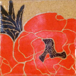 Stoneware plate, sgraffito carved poppies motif